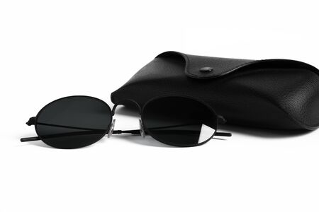 A pair of stylish retro black round-shaped sunglasse Banque d'images