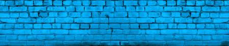 Bright Vivid Blue Brick Wall Background. Aged Wall Texture Toned.