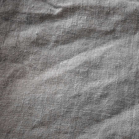 Gray Cotton Burlap Cloth Fabric Background Square. Brown Hessian Jute Textile Napkin Material. Natural Organic Linen Tablecloth On Table Surface.