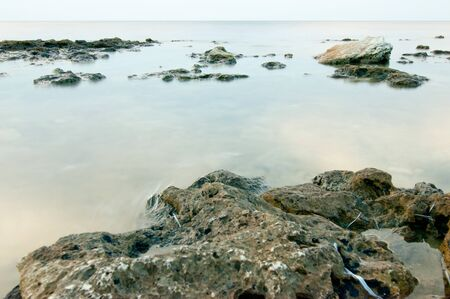 stillness: Seafront in the absence of waves