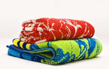 Two colour towels on a white fabric