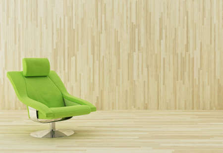 Green armchair in a wooden room Stock Photo
