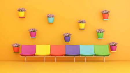colorful chairs and colorful pots of flowers Stock Photo