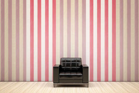 black chair in a room with striped wallpaper Stock Photo