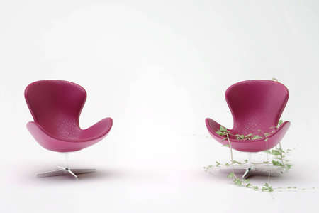 two purple leather chair entwined with ivy on a white background Stock Photo