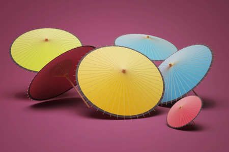 colored umbrellas on a purple background
