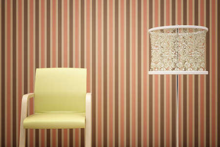 chair, lamp and striped wallpaper