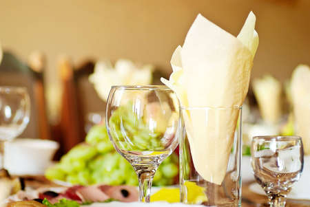 three glasses and a yellow cloth on the holiday table table Stock Photo