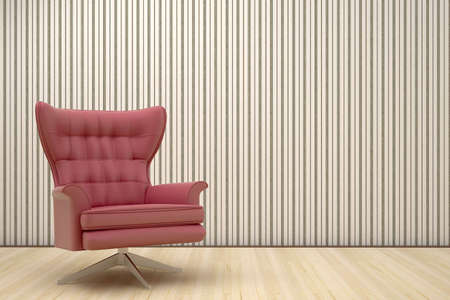 red chair in a room with striped wallpaper Stock Photo