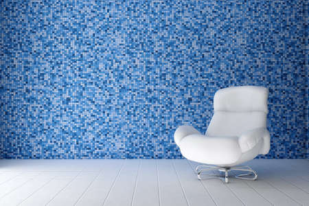 white leather chair in the room where the wall is decorated tile mosaic blue