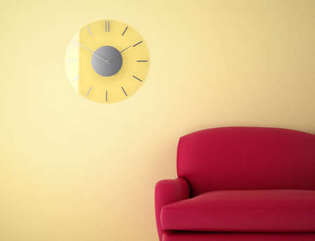 red sofa against a yellow wall clock Stock Photo