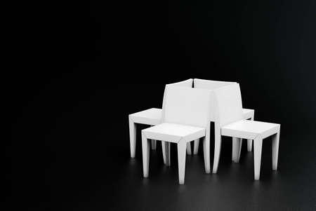 four white plastic chair in a dark room