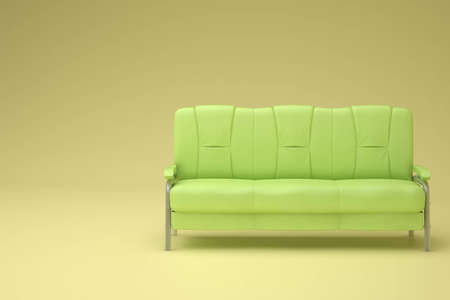 green sofa in the yellow room with soft lighting Stock Photo