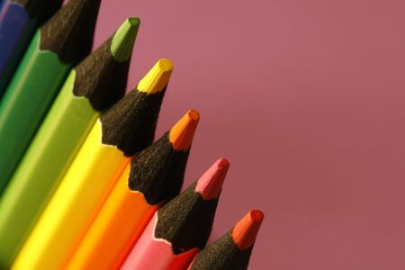 a part of  pencils with a simple  colorful background photo