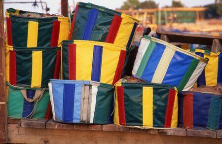 many colorful baskets for fishing nets in a river photo