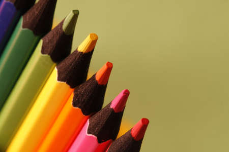 writing utensil: a part of  pencils with a simple green background