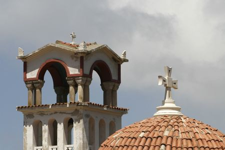 a simple frame with cross , roof and blue sky photo