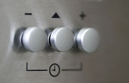 a silver knob of a oven taken with macro lens photo
