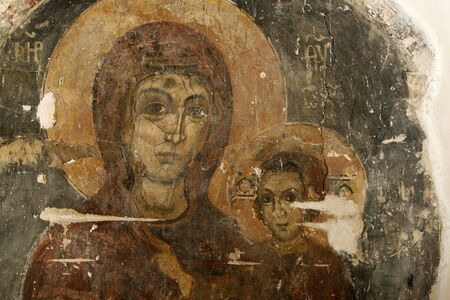 protestant: an icon in a wall with madonna and christ