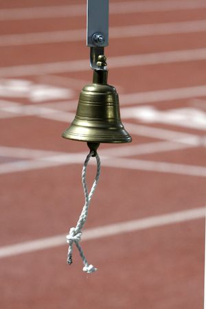 concurs: a gold colur bell in the athletic field