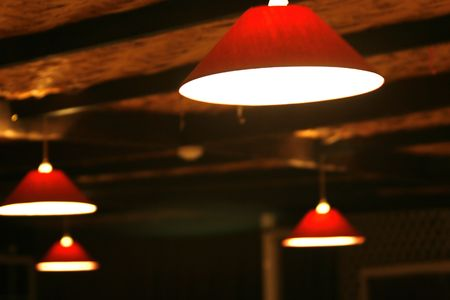 lamp stand: open roof red  lamps in a restaurant