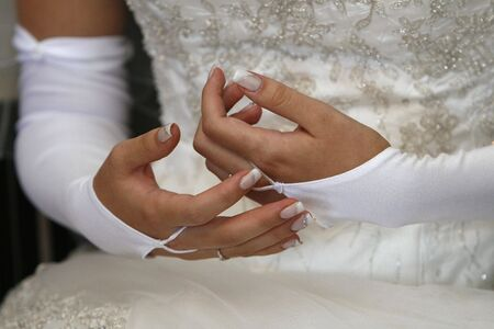 a close up with brides hands photo
