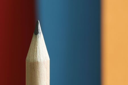autograph: a pencil  with a simple red-blue-yellow color background