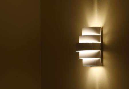 lamp shade in a wall at night photo