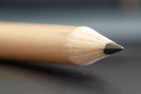 sharpen: a pencil  with a simple  black color background