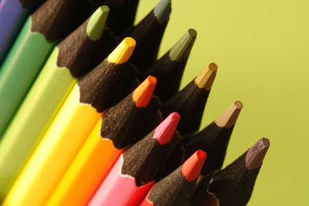 writing utensil: a part of  pencils with a simple  colorful background Stock Photo