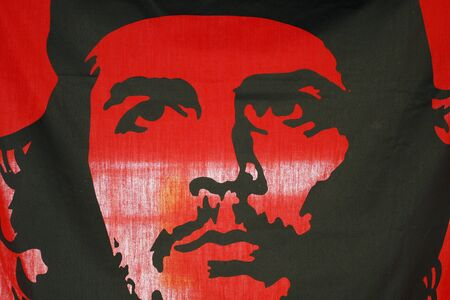 communists: a flag in black and red colors with Che on it
