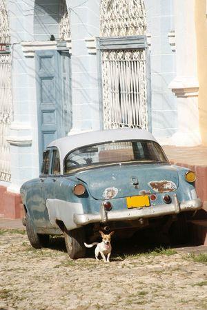 cuba flag: an old car  in Trinidad traditional village at Cuba