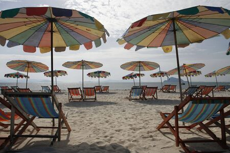 colorfully: colorfully sun beds and umbrellas in an island
