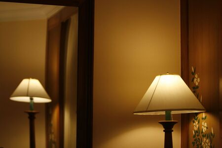 open standing lamps in a hotel room photo