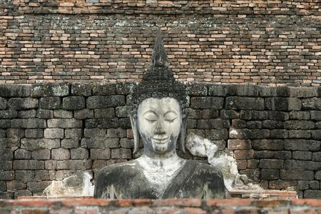 orison: a buddha face in a historical park in inland Thailand