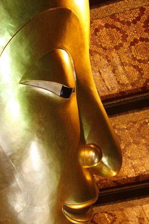 orison: a Buddha detail face  in a Wat at Thailand
