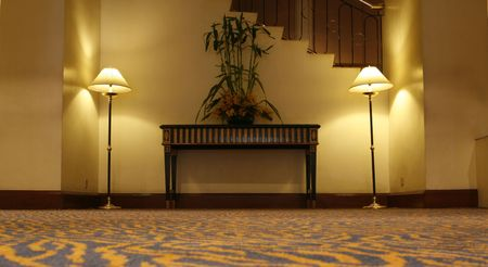 two standing lamps and a side table photo