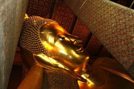 orison: a recline Buddha in a palace  at Bangkok  Stock Photo