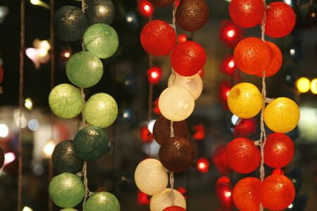 many colorful balls in differently colors taken at night photo
