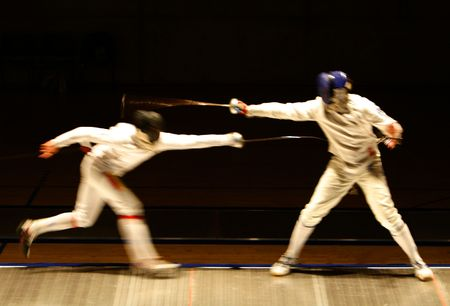 fencers: an action photography with two fencers Stock Photo
