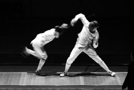 bout: an action photography with two fencers Stock Photo