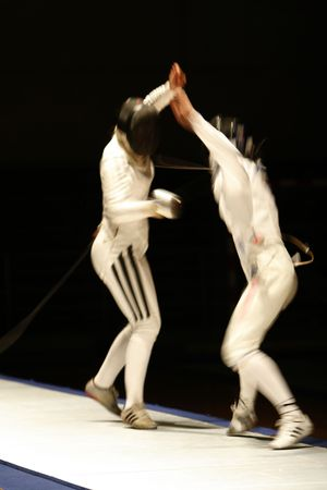 an action photography with two fencers photo