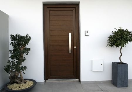 pvc: a simple frame with pvc brown door