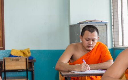 Samut Prakan, Thailand, October 13: unidentified monk Thailand to learn about Buddhism classes: front view of the college are in the top row of seats in the October 13, 2016 in Samut Prakan, Thailand. Editorial