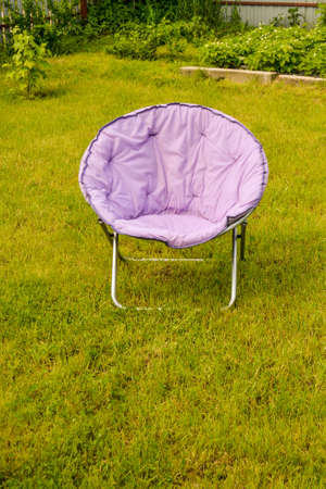Country lilac chair in the sun on the lawn