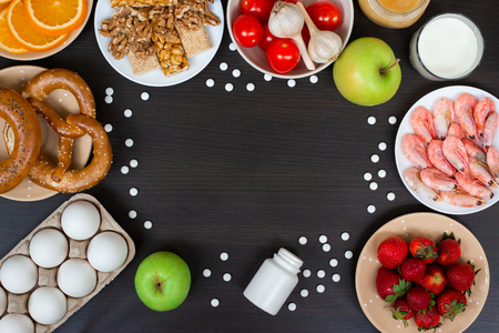 Food allergy. Allergens and antihistamin pills with copy space. Flat lay. Top view Archivio Fotografico - 126821791
