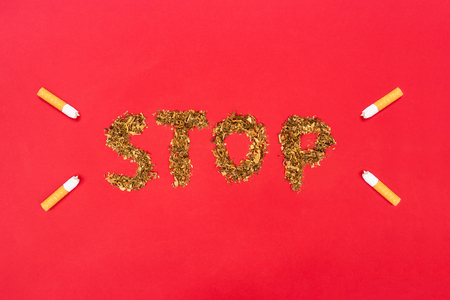 inscription stop from tobacco and cigarette butt. World no tobacco day concept. Top view.