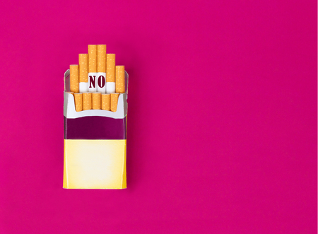 Open pack of cigarettes with the words No. World no tobacco day concept. Copy space