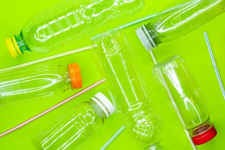 Empty plastic bottles and straws. Recycle waste concept. Top view. Flat lay