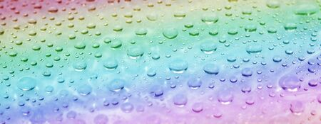 Rainbow water drops surface. Abstract summer background. Close-up view Stock Photo